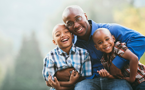 Father smiling with children